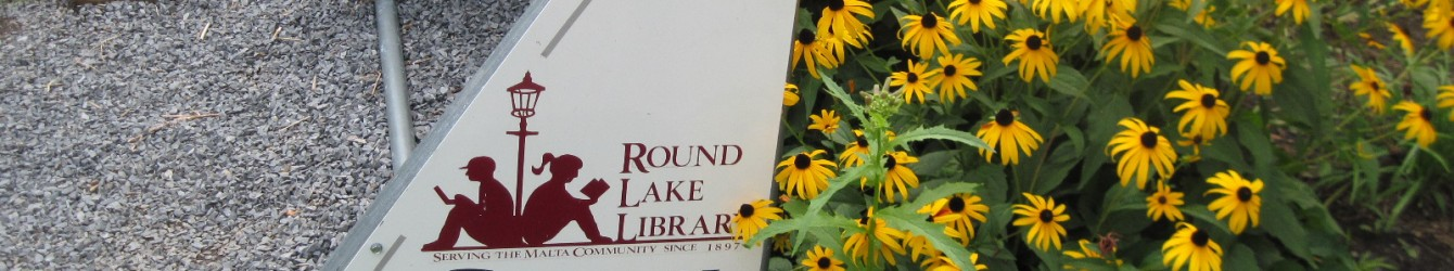 Bike rack at Round lake Library in August